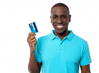 Person standing holding a credit card