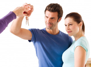 Young couple accepting a set of keys